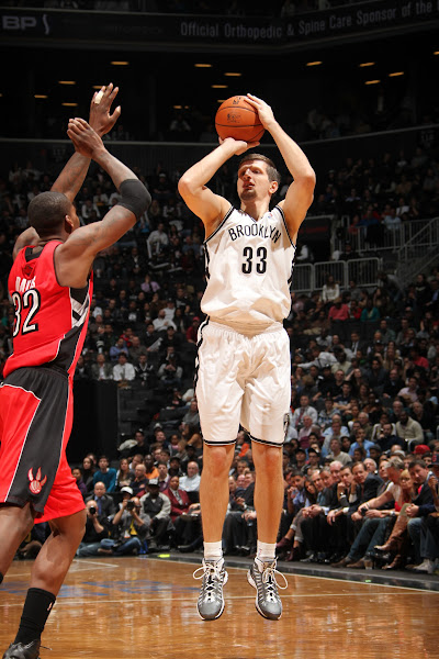 Photo: Mirza Teletovic #33 of the Brooklyn Nets shoots against Ed Davis #32 of the Toronto Raptors at the Barclays Center on January 15, 2013 in the Brooklyn borough of New York City in New York City.