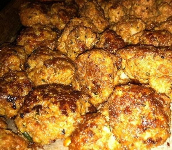 Put frozen (or thawed) meatballs in a large skillet.  Brown well.