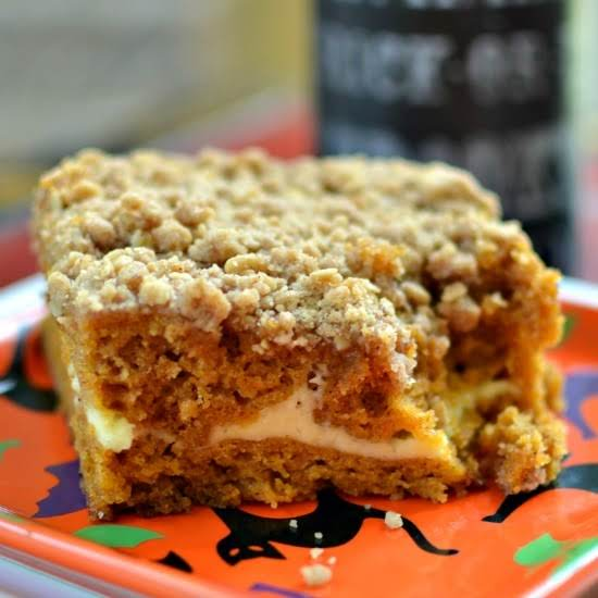 This Scrumptious Moist Pumpkin Cake Has A Lightly Sweetened Thin Layer Of Cream Cheese And A Luscious Crumb Topping.  Pumpkin Pie Spice Takes This Cake Over The Top With The Best That Fall Has To Offer.