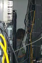 Photo: Kim Moir stuck behind server rack, Fall 2001