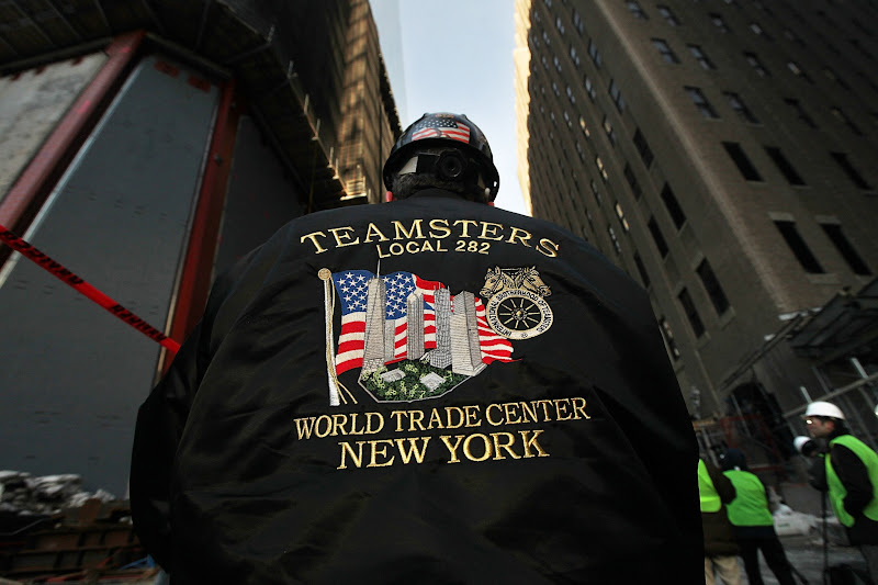 Photo: NEW YORK, NY - DECEMBER 12:  A worker wears a Teamsters union jacket as the first piece of the spire is hoisted atop One World Trade Center on December 12, 2012 in New York City.  The first of 18 sections of spire was hoisted atop the 104-story building by crane this morning.  (Photo by Mario Tama/Getty Images)