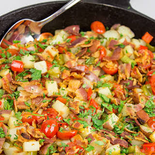 Skillet Potatoes with Bacon and Cherry Tomatoes.