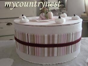 Photo: torta scatola rosa e bordeaux, grande