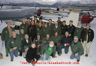 Photo: Saturday, Feb. 18, 2006  Anchorage, Alaska. Volunteer Iditarod Airforce pilots and others pose for a group photo at Merrill Field prior to loading straw and musher food bags into Cessna planes headed out to checkpoints along the trail.