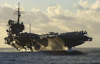 Photo: Aircraft carrier USS Kitty Hawk makes her approach to HMAS Success for a morning refuel, during exercise Talisman Sabre 2005.   HMAS Success conducted a dual refuelling with USS Kitty Hawk and USS Cowpens.