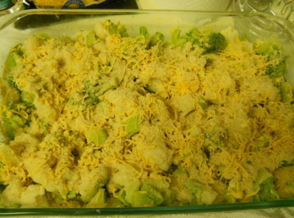 Place frozen cauliflower and broccoli into a 9 x 13 glass baking dish, mix...