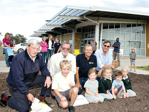 Rick Freeman, left, son of the late George Freeman, former University of Sydney Plant Breeding Institute director  Lindsay O'Brien, current director Northern Agriculture Guy Roth and director of the I A Watson Grains Research Centre Richard Trethowan, supervise the sowing of the historic wheat plot with Peter, Grace, Pascale, Harry and Millicent Freeman.  Grace and Harry are the children of Alice and Jack (son of Brian Freeman who is George Freeman's son). Peter, Pascale and Millicent are the children of  Samantha and Michael Freeman (Rick Freeman's son).