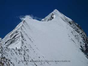 Photo: NW ridge goes to the ice-dome (which is 2/3rd of the route to summit).. as seen from Camp-III. Sherpas on the ridge...