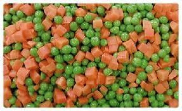 Once your stew is the thickness you like add your frozen peas and carrots....