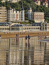 Photo: Playa de La Concha Reflections The beautiful sunset lighting, together with the low tide, combined to make great reflections on this popular beach in San Sebastian, Spain.