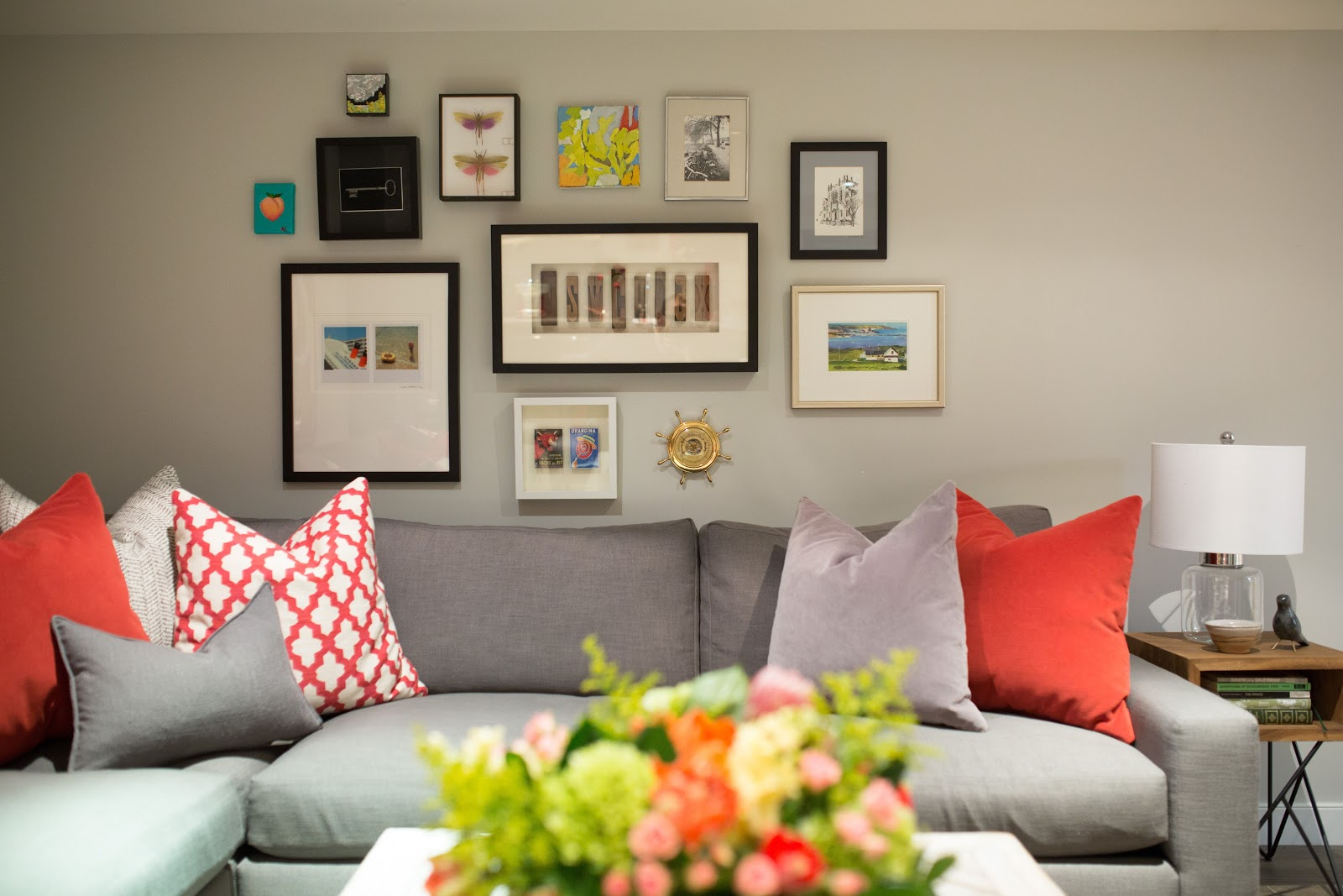 gallery wall framed travel finds from abroad keys photos butterflies art calgary interior design