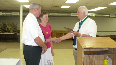 Photo: Past Grand Knight Rich Cook presenting the Family of the Year (2011-2012) plaque to Brother John Harper and his wife Mary Ann.