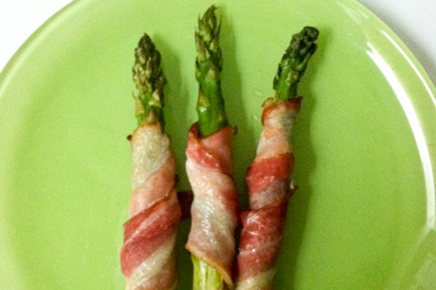 Photo: Bacon-Wrapped Asparagus Recipe: http://www.thedailymeal.com/dress-your-food-bacon-and-bacon-fat-slideshow#6