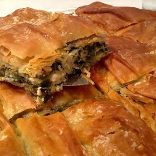 Traditional Greek Spanakopita recipe (spinach pie) with homemade phyllo.