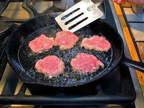 Photo: pan-frying thin patties of ground pork