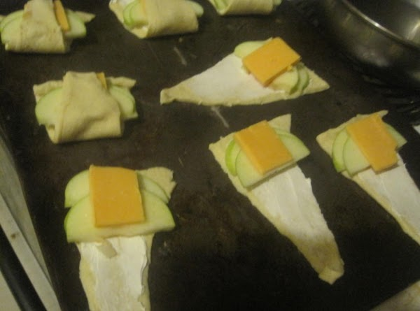 Top with 1/2 slice of cheddar cheese.