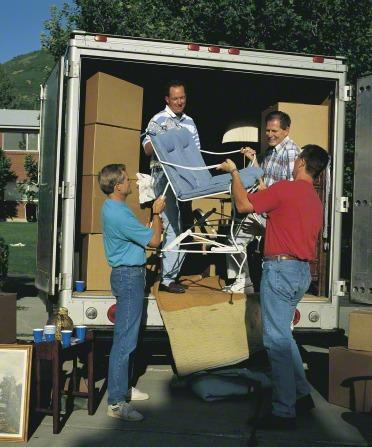 LDS members helping a neighbor move into a new home