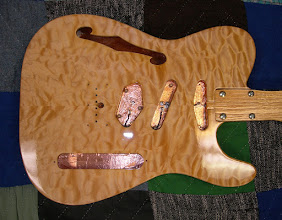 Photo: Quilted maple top. Musikraft thinline body. Custom center (Strat) pickup. Grounded copper shielding.