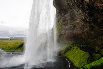 Photo: Serene running through the mist behind Seljalandsfoss
