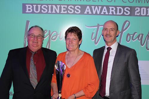 Bohena Pet Motel operators Danny and Vicki Allan are congratulated by Jamie Frankcombe from Whitehaven Coal.