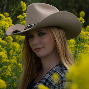 Cowgirl by Ton Hoelaars - People Portraits of Women ( cowgirl, flowers, spring, portrait, hat )