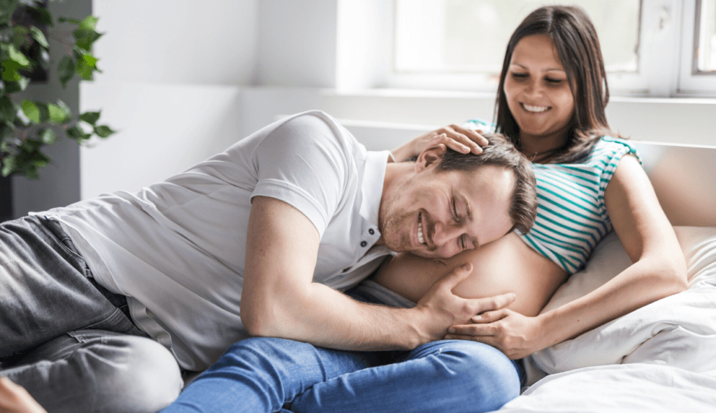 husband and wife are happy with healthy pregnancy