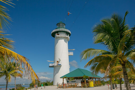 Go ziplining across the water from the Flighthouse at Harvest Caye in Belize.