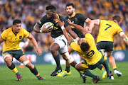 South Africa captain Siya Kolisi pushes away Australia's Will Genia during the Rugby Championship match at the Suncorp Stadium in Brisbane on September 8, 2018.
