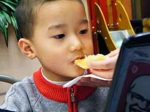 Photo: baby son eating while gaming.