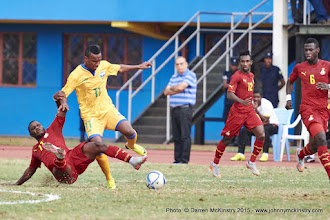 Photo: Patrick Sibomana (11) is brought down by Wakaso Mubarak's (11) challenge [Rwanda Vs Ghana AFCON2017 Qualifier, 5 Sep 2015 in Kigali, Rwanda.  Photo © Darren McKinstry 2015