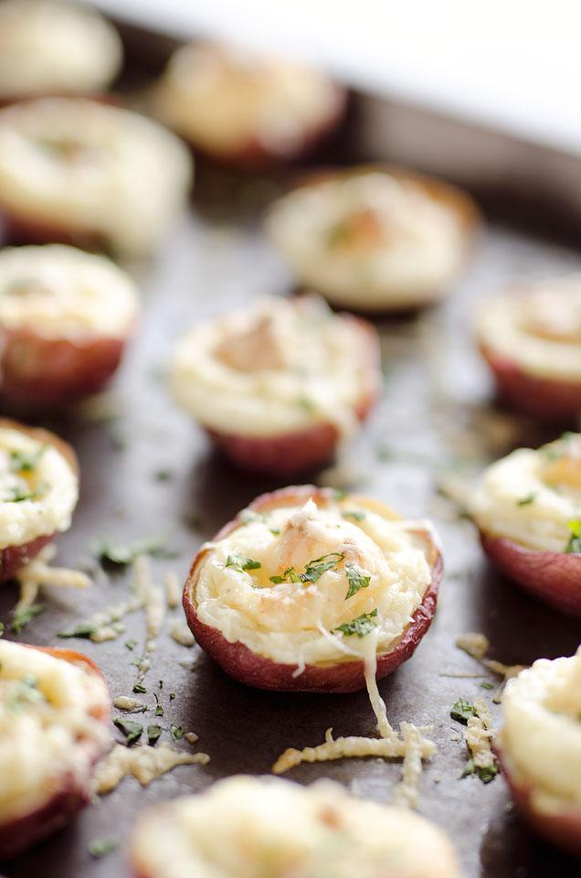 Twice Baked Ranch Potato Poppers are a crowd-pleaser with light and fluffy mashed potatoes mixed with Hidden Valley Ranch seasoning and light sour cream in a potato skin topped with shredded Parmesan for the perfect bite-sized appetizer!