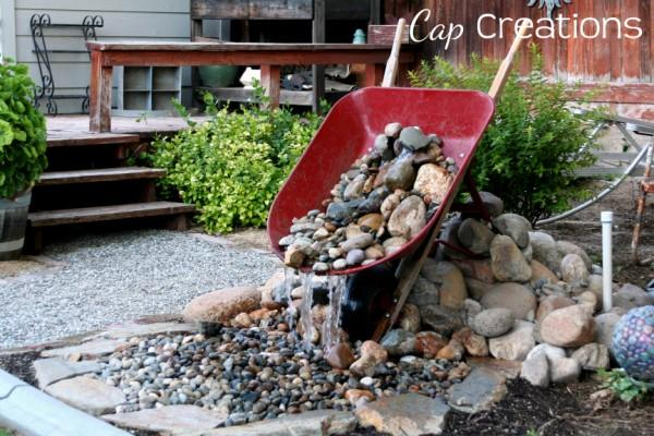 Wheelbarrow turned into a water feature.