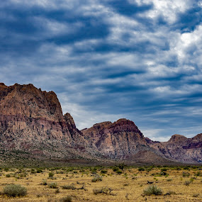 Storm at Red Rock by Fred Bartholomew - Landscapes Mountains & Hills ( stormy, mountains, mountain, desert, nevada, morning glory, red rock, cloudscape, cloud formation )