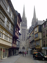 Photo: The Cathedral of Saint-Corentin (Quimper's first bishop), with its magnificent Gothic-style facade, was built between the 13th and 16th centuries making it the oldest Gothic structure in Lower Brittany. Its two towers are 250 feet tall; the spires were added in the 19th century. Once again, we have arrived during the mid-day closure, and so do not get to see the reportedly exceptional 15th century stained glass windows.