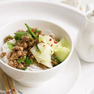 Stir-fried Pork And Pickled Cucumber On Rice Noodles.