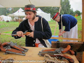 Photo: Mr. Plank sorting the weapons