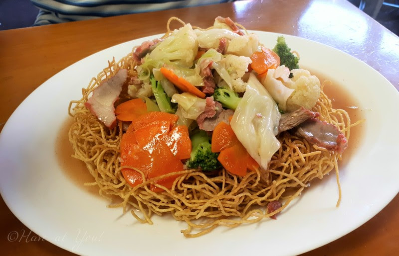 crispy egg noodles topped with pork and vegetables