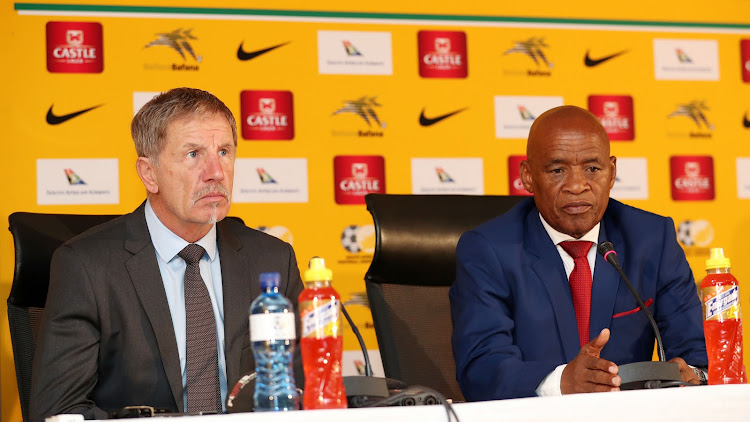 Bafana Bafana head coach Stuart Bexter (L) and the national team manager with Barney Kujane (R) during a media briefing at the SA Football Association headquarters in Nasrec in the south of Johannesburg.