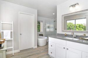 Clean bathroom without personal cosmetics is ready for home staging.