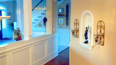 Photo: Foyer: 18'x 10' 8' Fluted columns Wainscoting and Chair rail complement the custom staircase