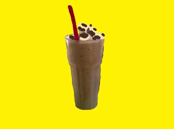 Coffee Shake With Whipped Cream And Shaved Chocolate Garnish.