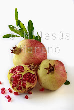 Photo: Pomegranate isolated on a white background