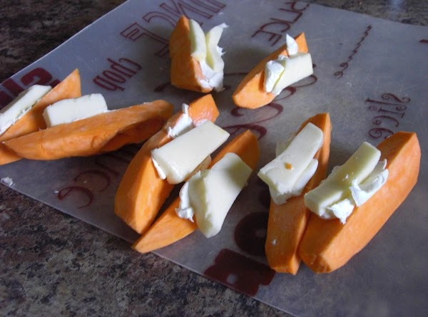 In the center of each wedge put a smear of cream cheese, then a...