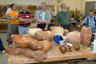 Photo: David, a local professional woodturner, brought a number of samples of his turnings to show what can be made with a bowl gouge.  His turnings are admired by members.