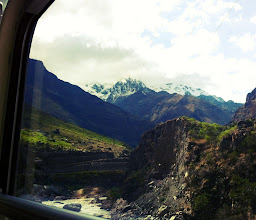 Photo: Past Ollantaytambo, scenery starts to change with huge snow-capped Andean peaks.  View from train.