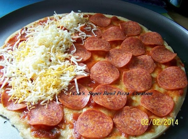 THEN BUILDING WITH PEPPERONI AND SEVERAL CHEESES.