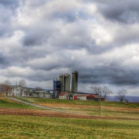 Bottom of the ridges by Kelly Bowers - Uncategorized All Uncategorized ( farm silo barn landscape sky backroads )