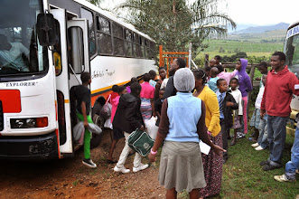 Photo: This bus made it up the hill, but shouldn't have. We thought we'd never get it to unplug the entrance. There was no place for it to turn around and the driver couldn't see to back up. What a med. Notice the little one with shirt and tie. How cute.