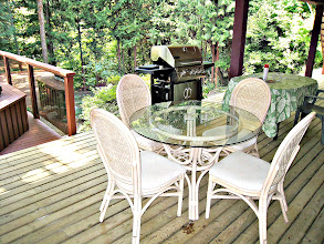 Photo: GARDEN LEVEL - YOU ALSO HAVE A COVERED DECK TO ENJOY DINNER ON COOLER SUMMER EVENINGS