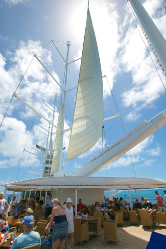 The sails go up as Wind Surf departs from Barbuda in the Caribbean.